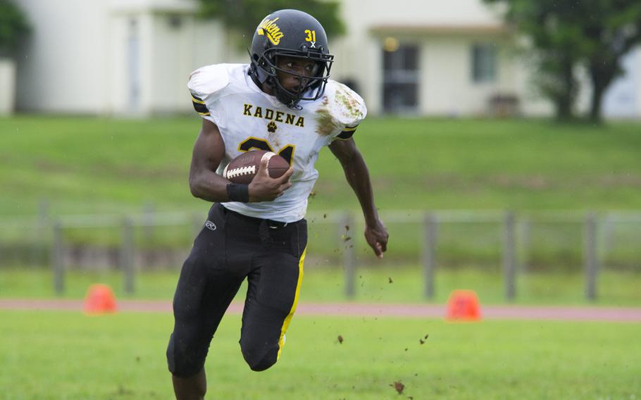 Xavier Peace, running back for the Kadena Panthers, runs the ball during a game against the Kubasaki Dragons at Mike Petty Stadium on Camp Foster, Okinawa, Japan, Saturday, Sept. 7, 2019.