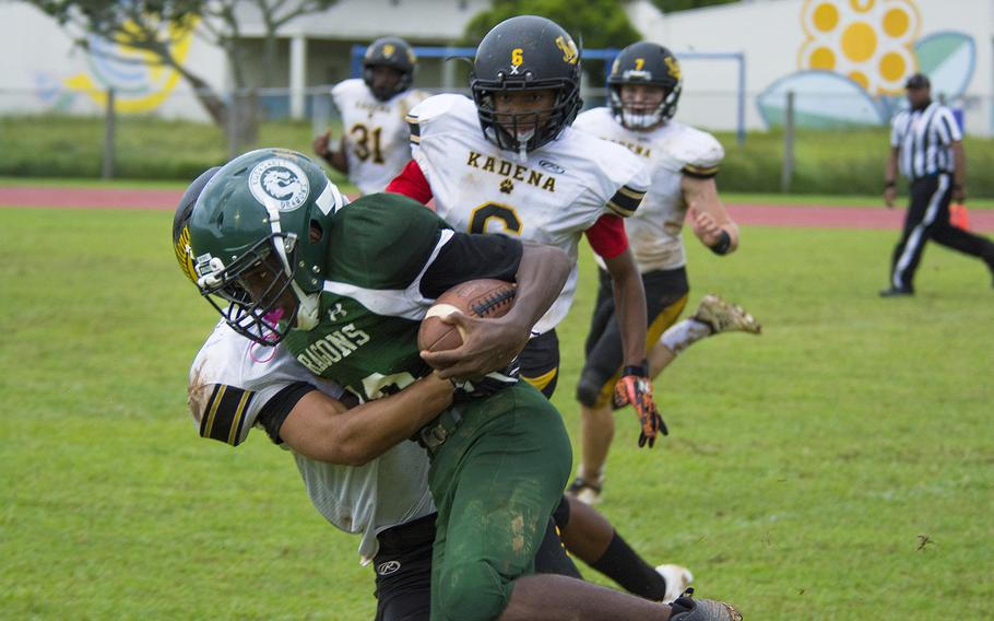 Jaylan Mayers, a player for the Kubasaki Dragons, runs the ball during a game against the Kadena Panthers at Mike Petty Stadium on Camp Foster, Okinawa, Japan, Saturday, Sept. 7, 2019.