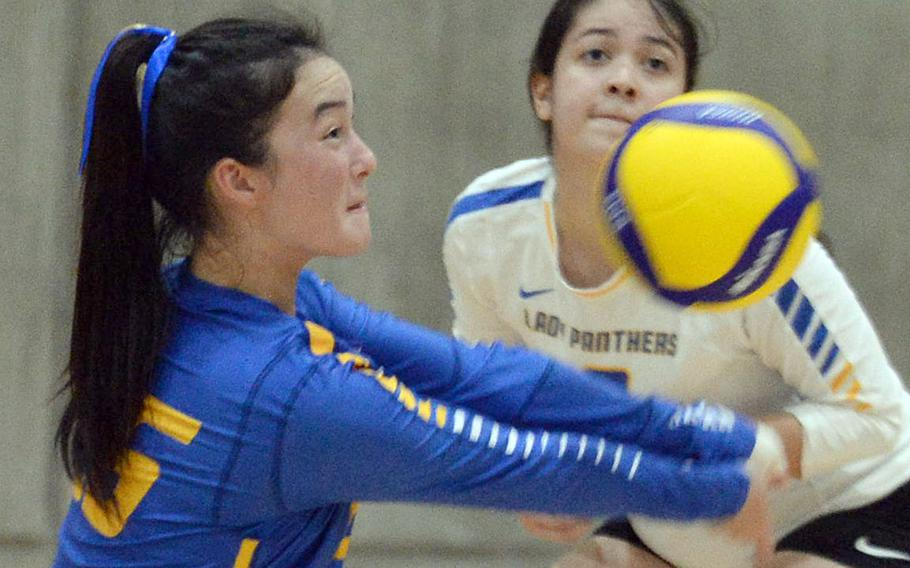 Yokota senior Emily Taynton digs the ball during Tuesday's Kanto Plain girls volleyball match, won by Christian Academy Japan in four sets.