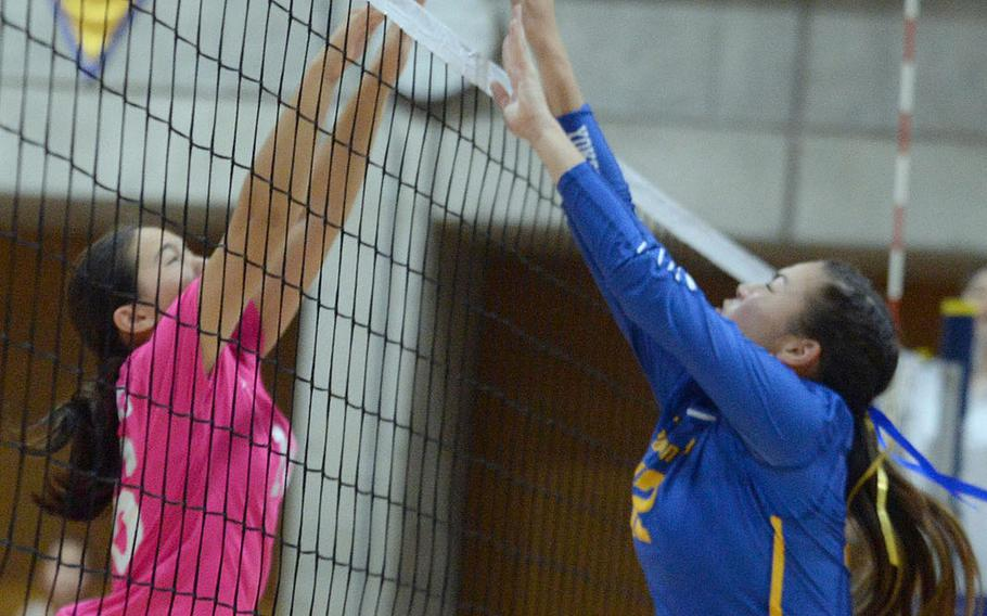 Christian Academy Japan's Rina Seminoff and Yokota's Chloe Dozier go up at the net for the ball during Tuesday's Kanto Plain volleyball match, won by the Knights in four sets. The match featured the winners of the last three Far East Division II titles, CAJ last season and Yokota in 2016 and 2017.