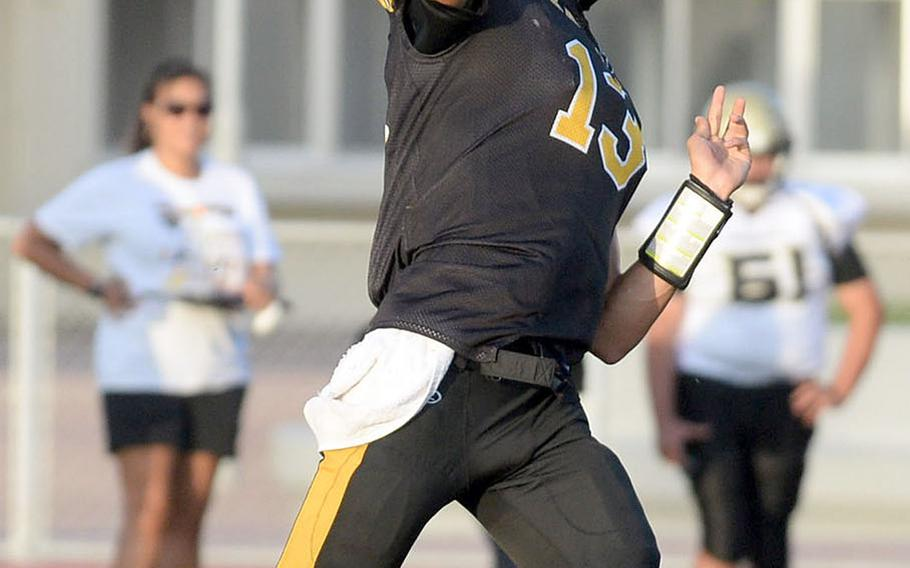 Kadena quarterback Jack Carey launches a pass against Humphreys.