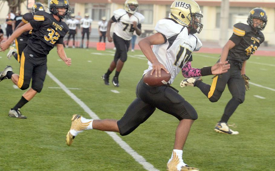 Humphreys quarterback Deontaye Gregory tries right end and tries to leave Kadena defenders in  his wake.