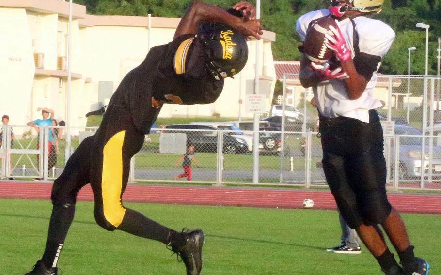 Humphreys receiver Junior Gregory lsnags a pass against Kadena's Xavier Peace.