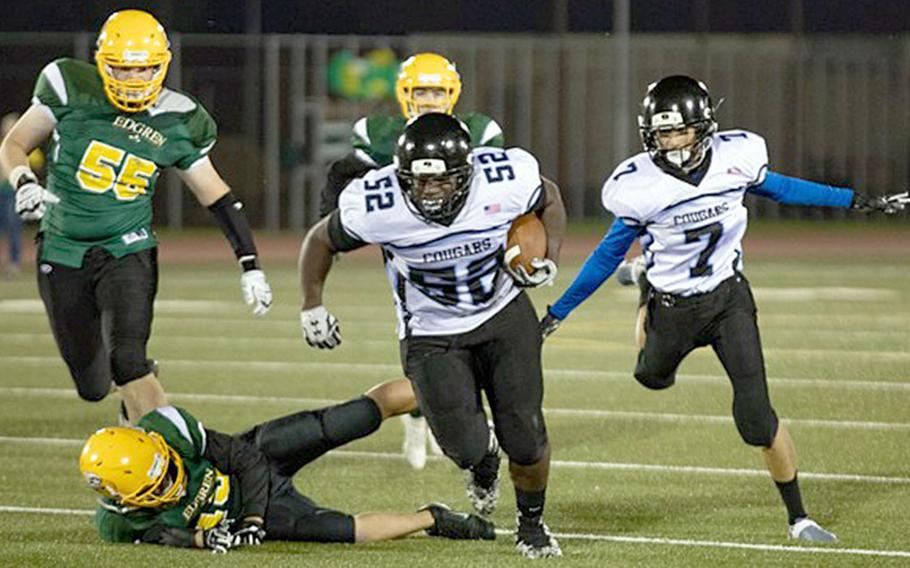 Osan's Gregory Lunn rambles toward the end zone for one of the Cougars' five rushing touchdowns.