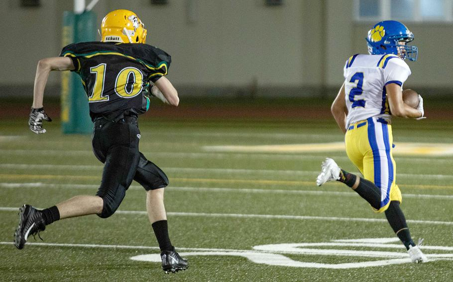 Yokota's Kura Sato races to the end zone for one of his three receiving touchdowns.