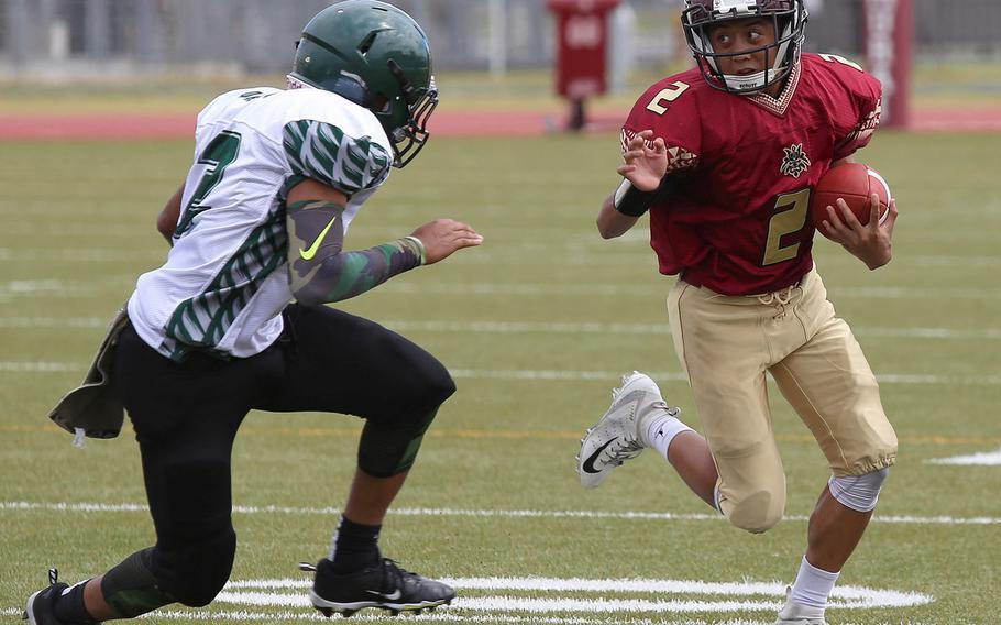 Matthew C. Perry quarterback Joel Pacleb tries to elude Daegu's William Hamilton.