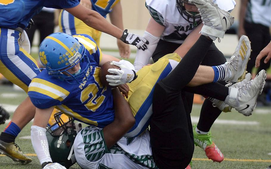 Yokota's Ethan Smith is brought down by Daegu's DeQuandre Moore.
