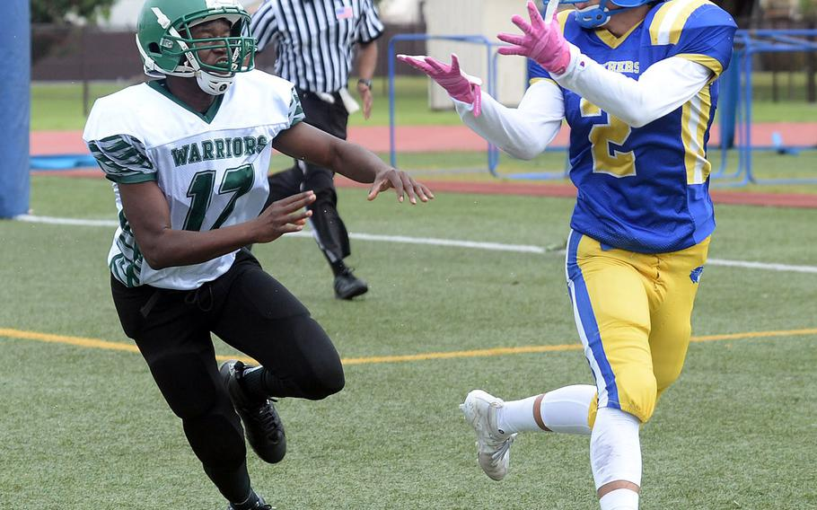 Yokota's Kura Sato hauls in a 9-yard touchdown pass in front of Daegu's Andrue McCall.