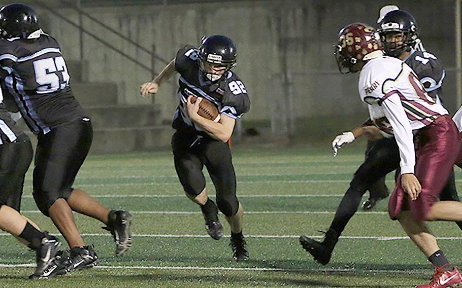 Jacob White scored the second touchdown for Osan to give the Cougars a short-lived 14-7 lead over Perry.