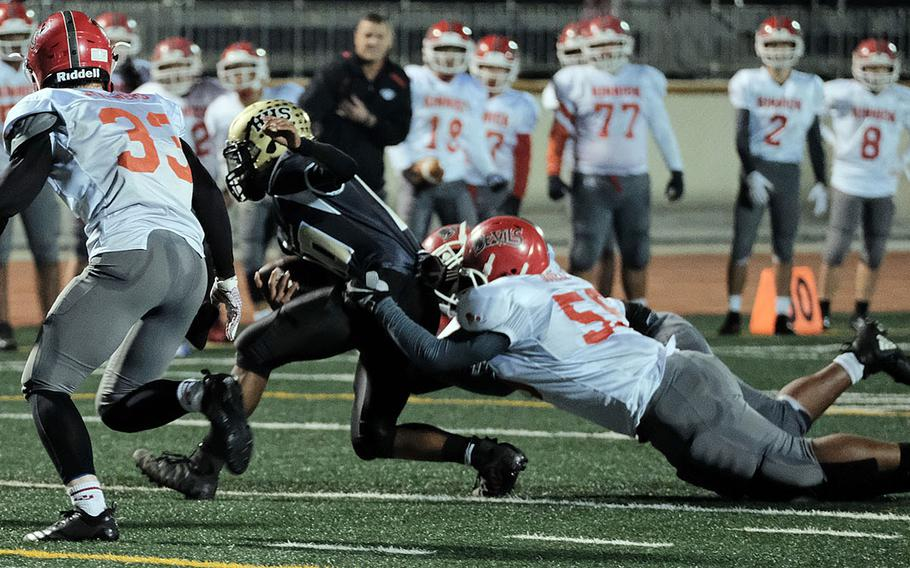 Humphreys quarterback Deontaye Gregory drags a couple of Nile C. Kinnick defenders.