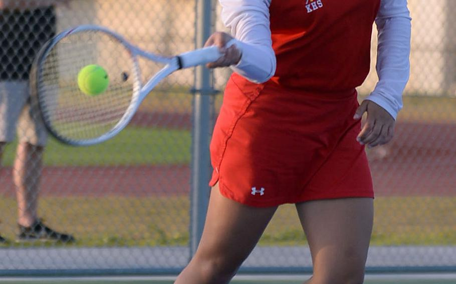 Nile C. Kinnick's Amary-Gail Perfecto slaps a forehand return during Friday's DODEA-Japan tennis tournament semifinals. Perfecto beat Robert D. Edgren's Elizabeth Rice 8-5.