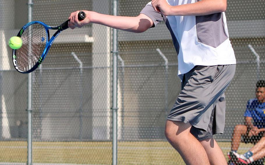 Matthew C. Perry's Luke Howard launches a forehand return during Friday's DODEA-Japan tennis finals. Howard won in the first round 8-1 over Zama's Joshua Allen, but lost in the quarterfinals 8-2 to Nile C. Kinnick's Justin Crouch.