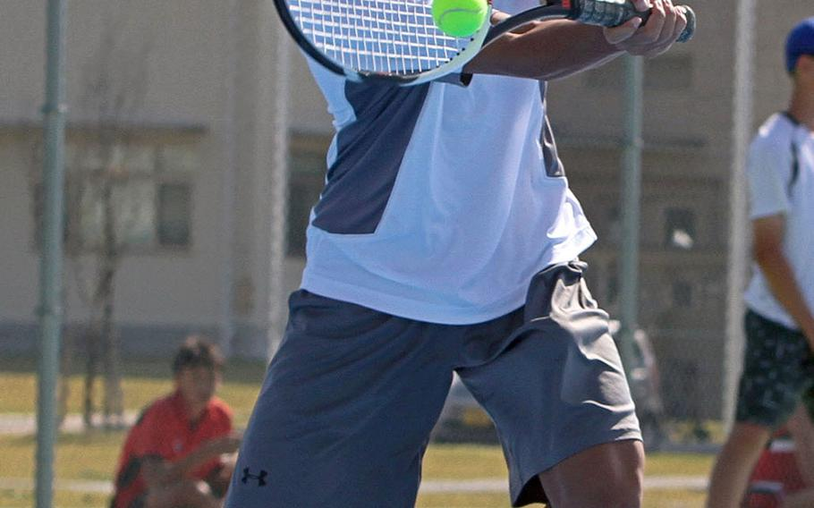 Matthew C. Perry's Payton Strain hits a forehand return during Friday's DODEA-Japan tennis tournament. Strain lost his singles match 8-1 to NIle C. Kinnick's Bodhi Kuiper.