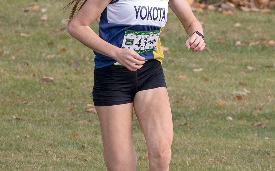 Yokota sophomore Aiko Galvin nears the finish line en route to capturing the overall and Division II titles in the Far East cross country meet. She joins her older brother Daniel, now running for Division I Iona (New York), as a Far East champion.