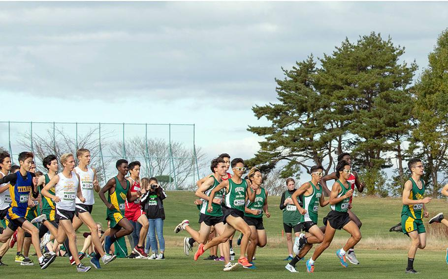 The boys field takes off from the start line, led by eventual Division I and overall winner Hanokheliyahu Gailson of Nile C. Kinnick, far right.