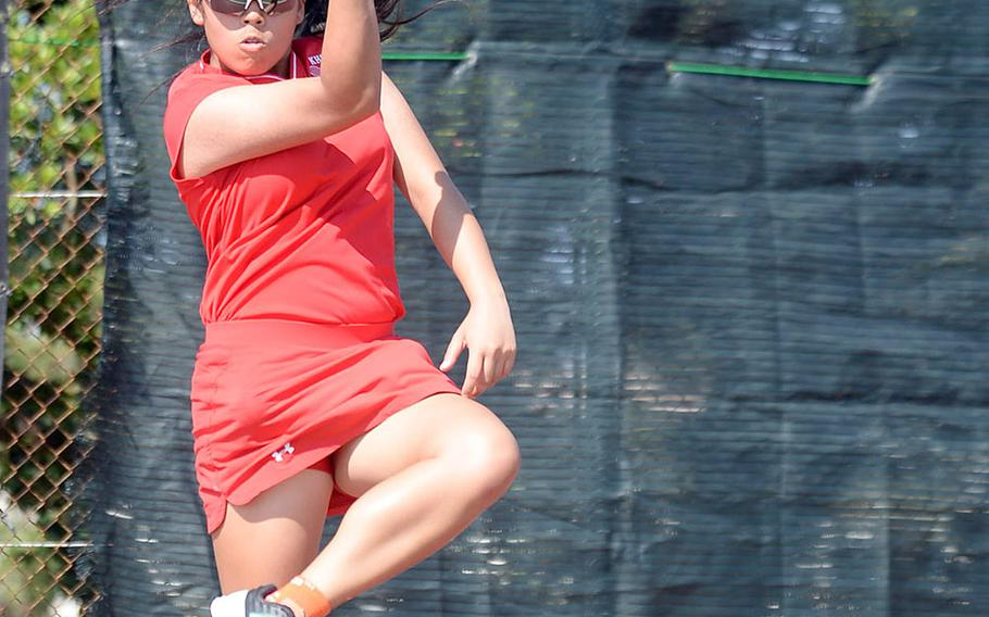 Nile C. Kinnick's Amary-Gail Perfecto hits a forehand shot against Arisa Manuel of Kubasaki during Wednesday's Far East tennis tournament girls singles action. Perfecto won 8-0.