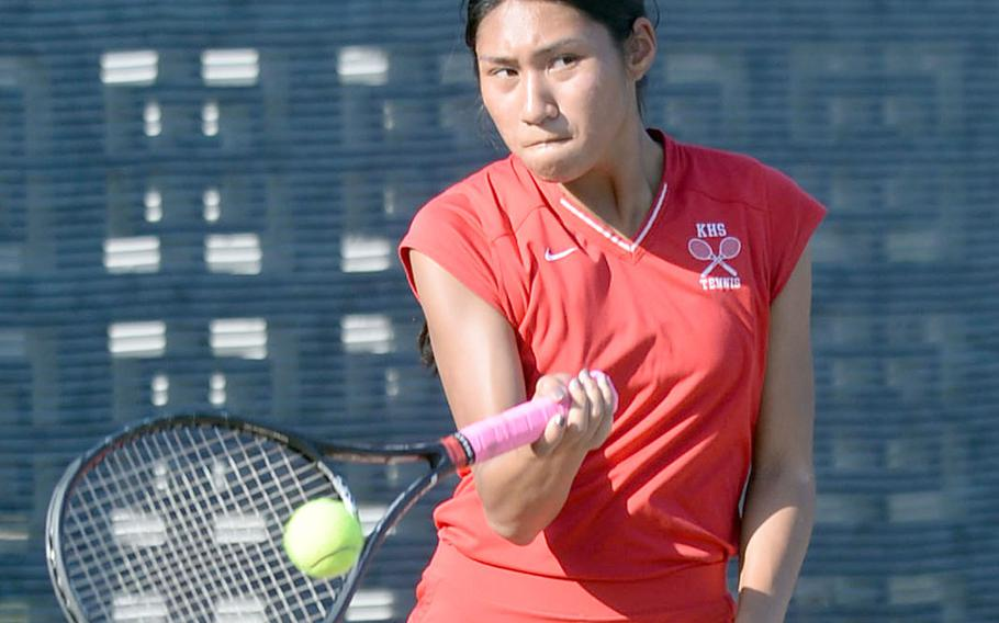 Nile C. Kinnick's Aleigh Lamis hits a forehand return during Wednesday's Far East tennis tournament girls singles quarterfinal. Lamis lost to Kadena's Ally Johnson 8-2.