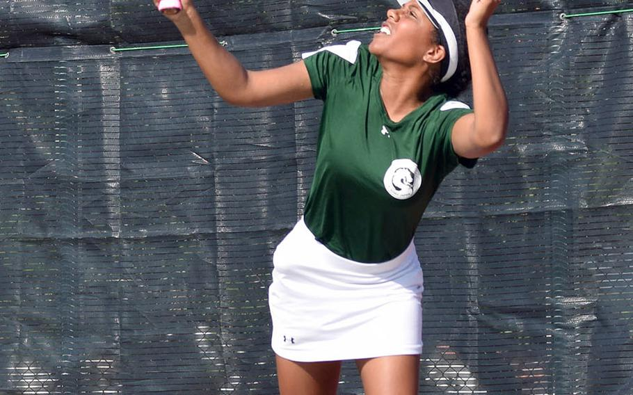 Kubasaki's Chante Broomes smacks an overhand return during Wednesday's Far East tennis tournament girls singles action. Broomes beat Matthew C. Perry's Olivia Archambault 8-1 in the first round, then lost 8-5 to Nile C. Kinnick's Aleigh Lamis in the second round.