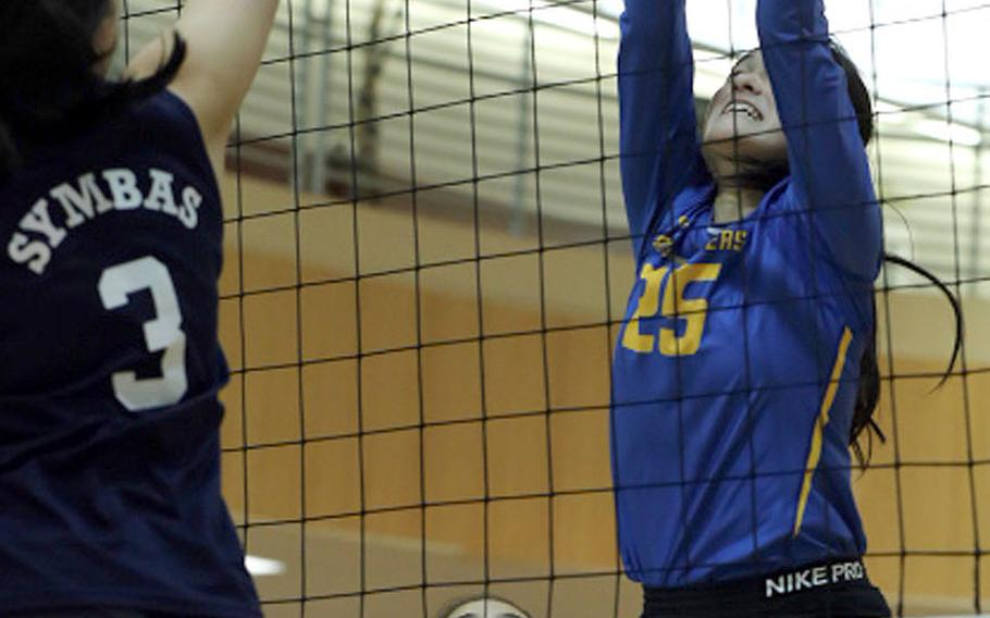 Sacred Heart's Erika Takei tries to send the ball past Emily Taynton of Yokota during Thursday's Far East Division II volleyball tournament pool match. The Panthers won in three sets.