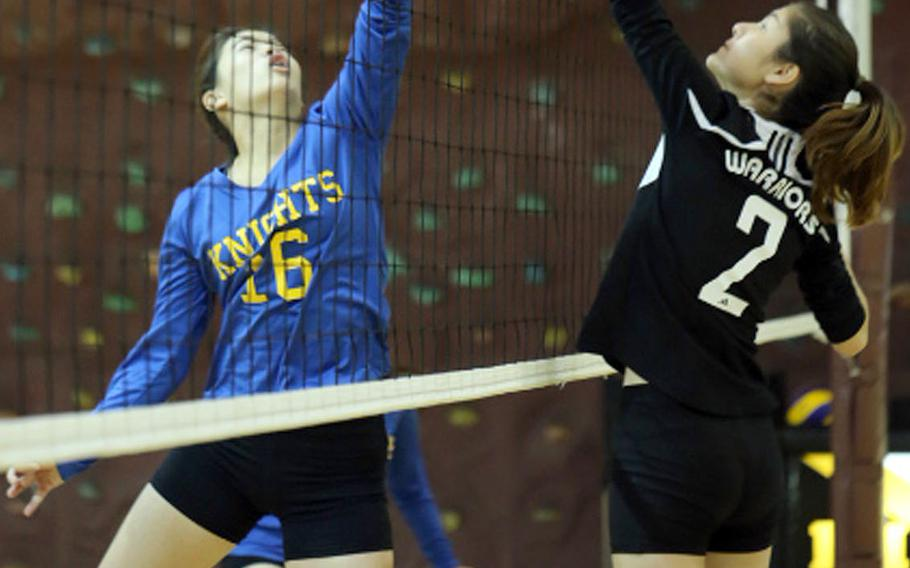 Christian Academy Japan's Rina Seminoff and Daegu's Victoria Sergi battle at the net for the ball during Thursday's Far East Division II volleyball tournament pool match. The defending champion Knights won in two sets.