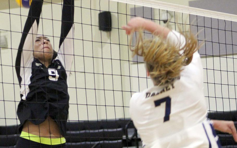 Guam High's Malia Dabney spikes past Humphreys' Natalie Goode during Thursday's Far East Division I volleyball tournament pool match. The Blackhawks won in two sets.