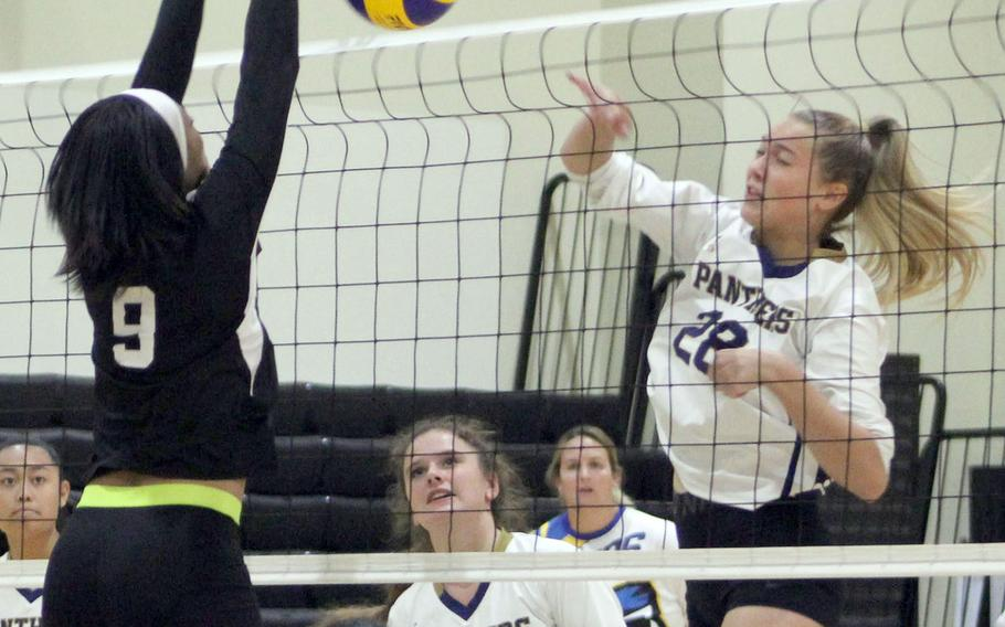 Guam High's Eden French tries to spike past Humphreys' Natalie Goode during Thursday's Far East Division I volleyball tournament pool match. The Blackhawks won in two sets.