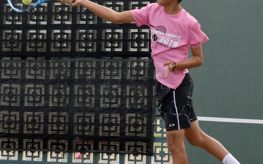 Kadena's Justin Saavedra hits a forehand smash during Thursday's Far East tennis tournament boys doubles. Saavedra and partner Matt Steele lost in the first round.