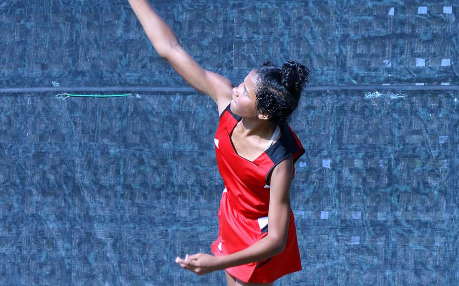 E.J. King's Jae Garland serves during Thursday's Far East tennis tournament girls doubles. She and partner Halle Santiago won twice to reach Friday's quarterfinals.