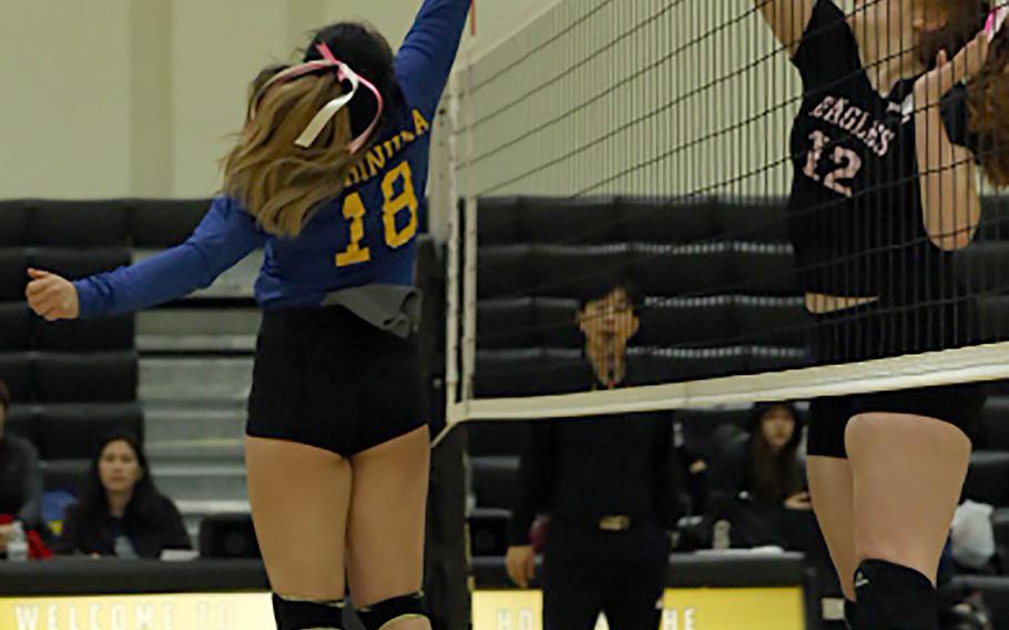 Christian Academy Japan's Mitsuki Hishinuma and Robert D. Edgren's Lydia Stone battle for the ball during Friday's Far East Division II tournament pool match. The Eagles won and earned the No. 2 seed into the single-elimination playoffs.