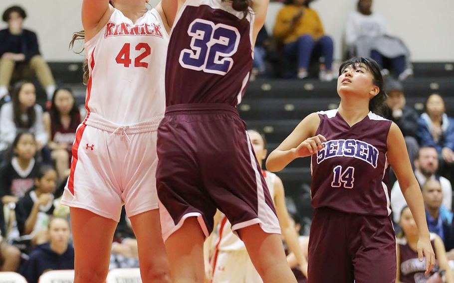 Kinnick's Madelyn Gallo puts up a shot over Seisen's Lisa Purcell during Thursday's Kanto Plain girls basketball game. The Red Devils won in overtime 44-35.
