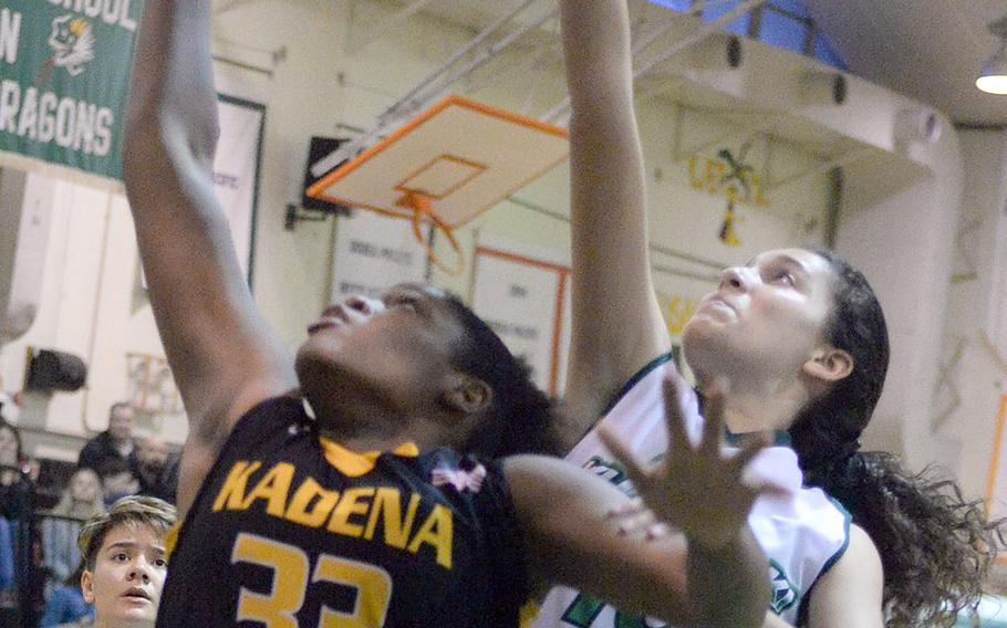 Kadena's Alexis Boyer and Kubasaki's Sophie Grubbs sky for a rebound during Friday's Okinawa girls basketball game. The Panthers won 45-15.