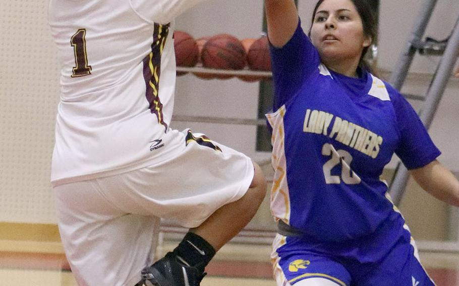 Matthew C. Perry's Jialee Asperer goes up for a shot against Yokota's Aaliyah Velasquez during Friday's DODEA-Japan girls basketball game. The Panthers won 56-23.