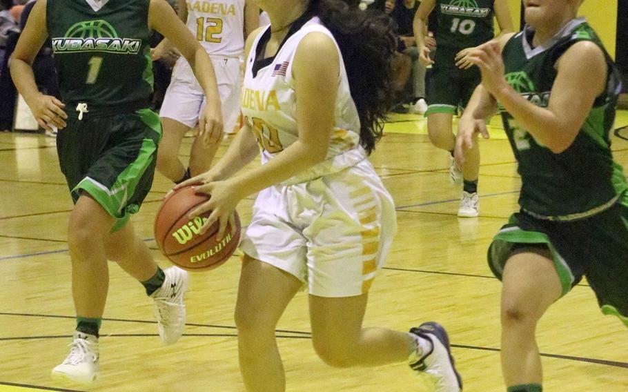 Kadena's Mikayla Benitez drives to the basket between Kubasaki's Urara Williams and Ari Gieseck during Friday's Okinawa girls basketball game. The Panthers won 53-21.