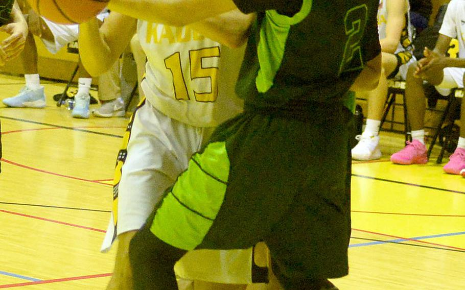 Kadena's Beau Black battles Kubasaki's Erik Camacho for the ball during Friday's Okinawa boys basketball game. The Panthers won 76-43.