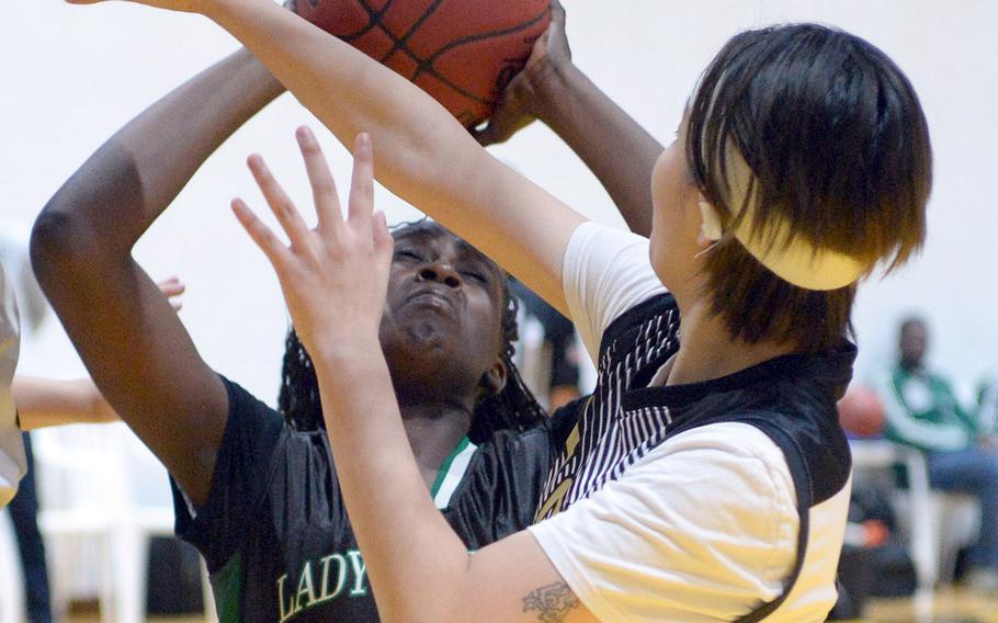 Daegu's Jya Van shoots against Taejon Christian's Sylvia Yun during Friday's Korea Blue girls basketball game. The Warriors won 54-22.