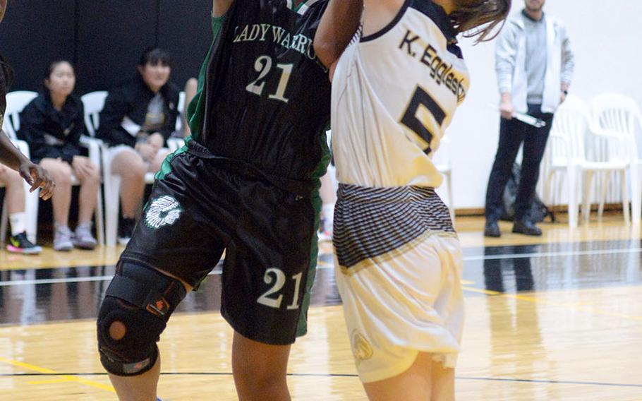 Daegu's Katrina Vasquez tries to shoot over Taejon Christian's Katie Eggleston during Friday's Korea Blue girls basketball game. The Warriors won 54-22.
