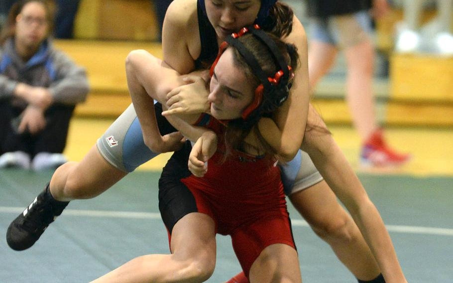 Osan's Kelly Kenyon gets the upper hand momentarily on Seoul Foreign's Lucie Mathieu during Saturday's Daegu quad-meet. Mathieu pinned Kenyon in 2 minutes, 33 seconds.