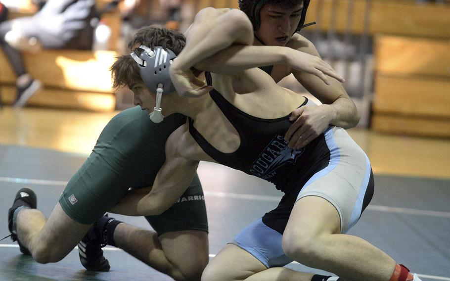 Daegu's Charles Lyons, back, and Osan's Toy Williams tangle at 141 pounds during Saturday's Daegu quad-meet. Williams won by pin in 2 minutes, 59 seconds.