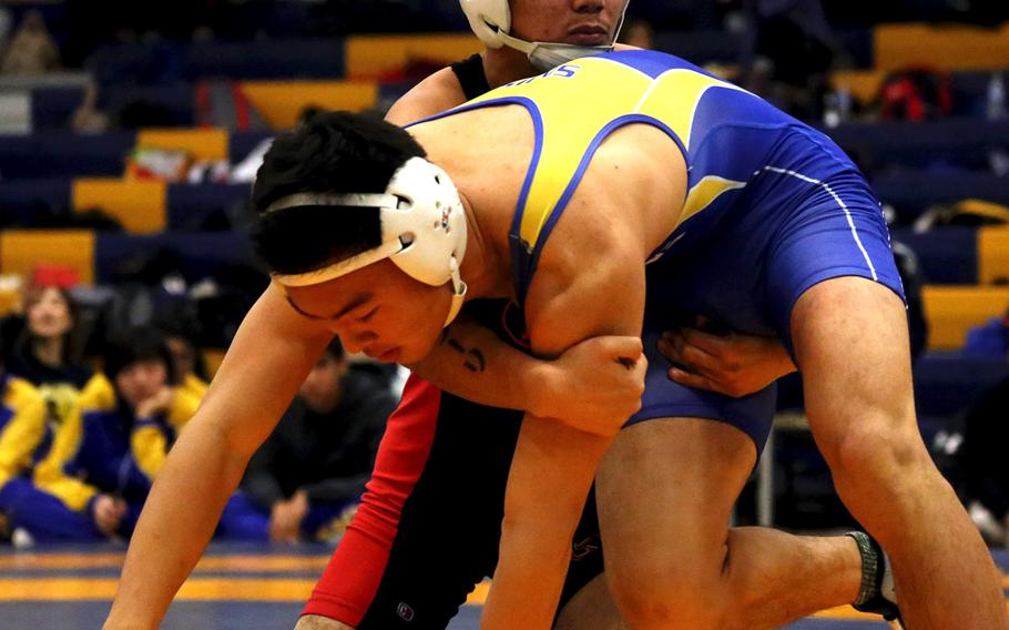 St. Mary's International's Hikaru Shimada, front, and Nile C. Kinnick's Josiah Millare tangle at 141 pounds during Saturday's Yokota Invitational. Shimada would go on to win the title.