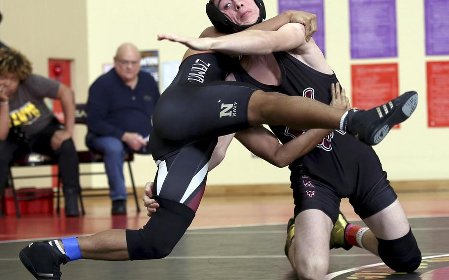 Matthew C. Perry's James Williams scores a technical fall over Zama's Joseph Sanchez at 135 pounds during Saturday's Perry Invitational.