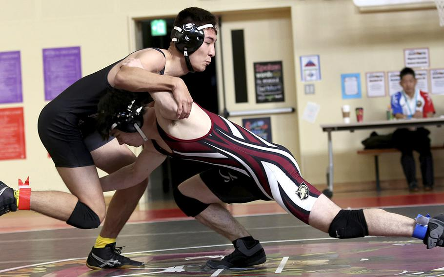 Zama's Eligh Cabe, left, pinned Matthew C. Perry's Matthew Adams twice, but the Samurai won two dual meets against the Trojans during Saturday's Perry Invitational.