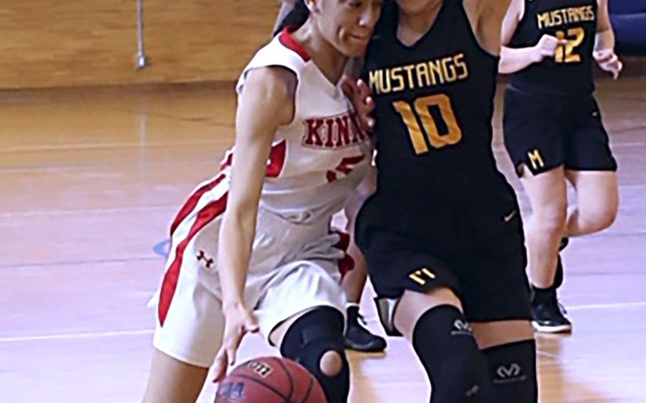 Nile C. Kinnick's Ernestina Roberts dribbles against American School In Japan's Cora Eaton during Saturday's Kanto Plain girls basketball game. The Mustangs won 18-16.