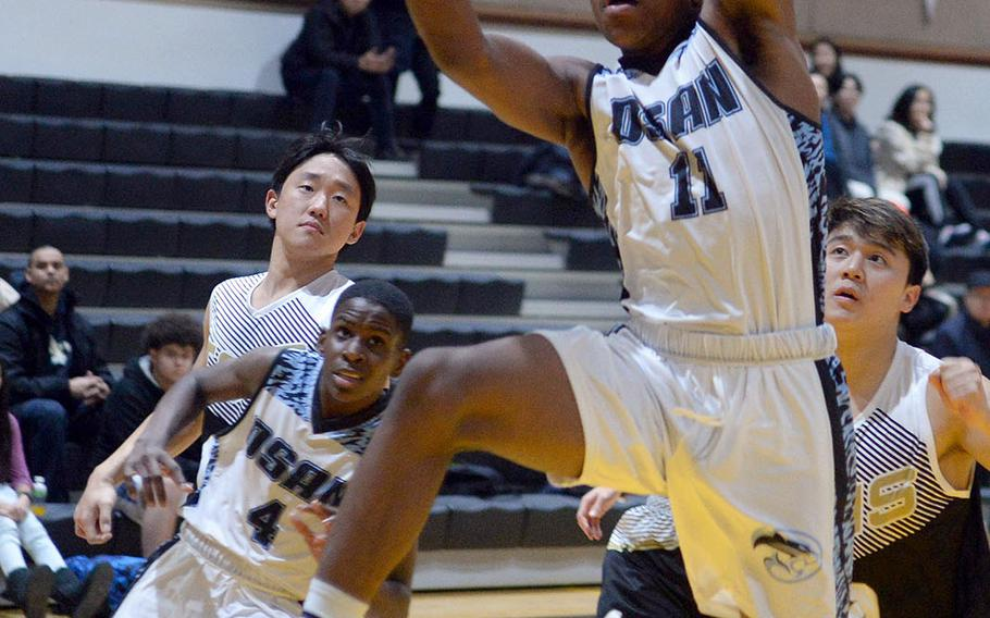 Osan's Bryson Goldsmith drives for a shot against Taejon Christian during Tuesday's Korea Blue boys basketball game. The Cougars won 58-53, their second straight win, both against TCIS.