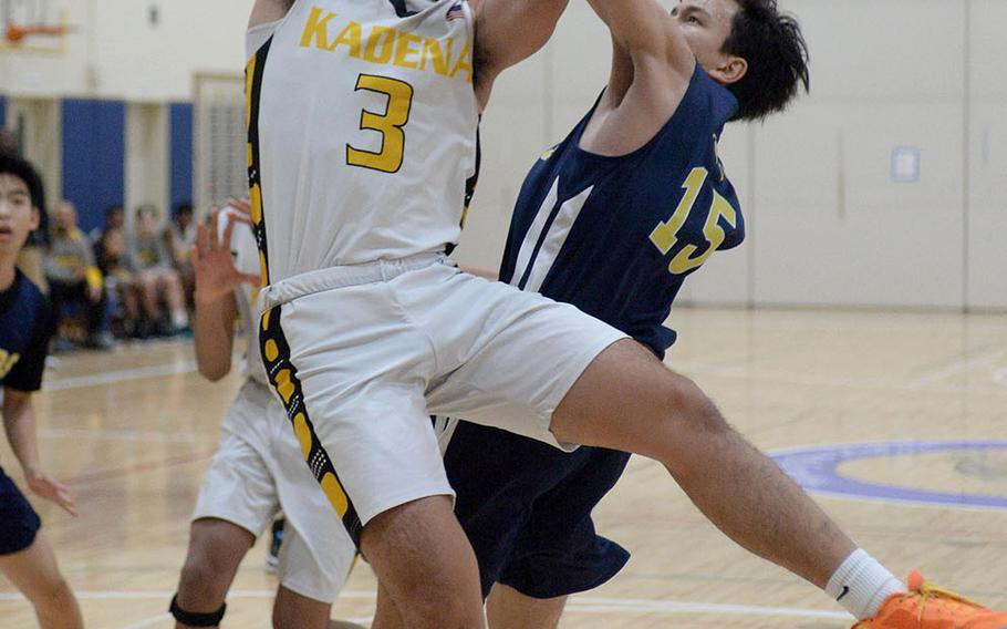 Kadena's Casey Cox leans in for a shot against Taipei American during Saturday's Taipei Basketball Exchange boys game. The Panthers won 86-79 in double overtime.