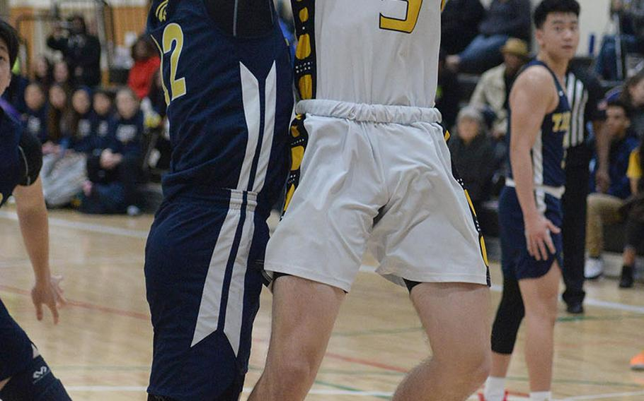 Kadena's Blake Dearborn goes up for a shot against Taipei American during Saturday's Taipei Basketball Exchange boys game. The Panthers won 86-79 in double overtime.