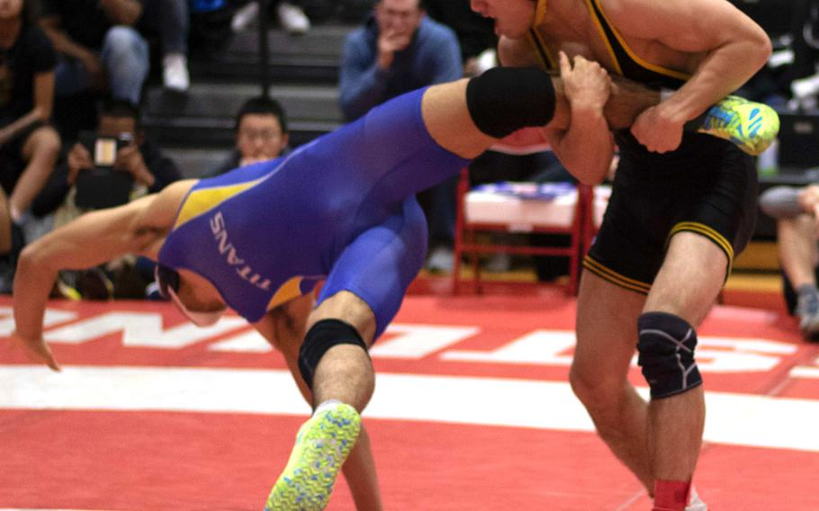 American School In Japan's Rin Zoot, last year's Far East Outstanding Wrestler, gets the upper hand on St. Mary's Warren Koslow in the 158-pound final.