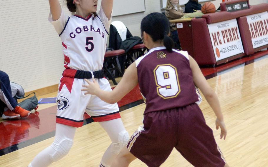 E.J. King's Ellen May looks to pass against Noda Gakuin during Friday's Japan girls basketball game. Noda Gakuin won 57-32.