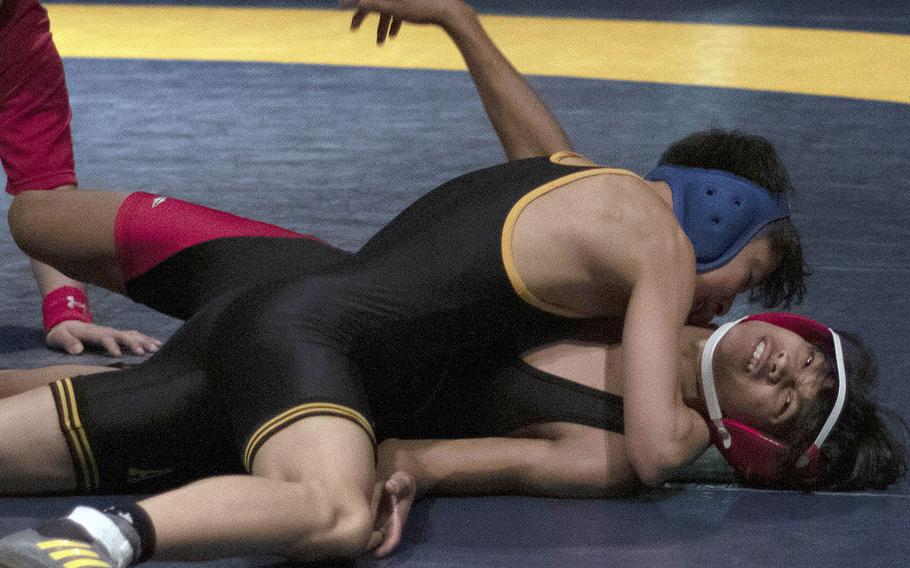 American School In Japan's Bryce Clement pins Nile C. Kinnick's Michael Lozano to win the 108-pound title in the Kanto finals.