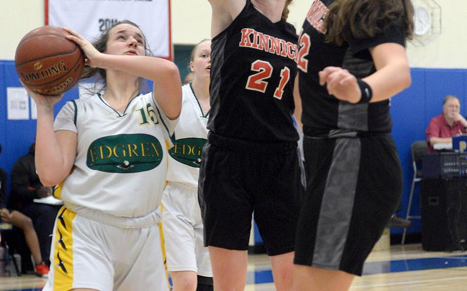Robert D. Edgren's Destiny Jagers finds herself bottled up by Nile C. Kinnick's Cassi Boyer and Madelyn Gallo during Friday's DODEA-Japan girls semifinal, won by the Red Devils 47-18.