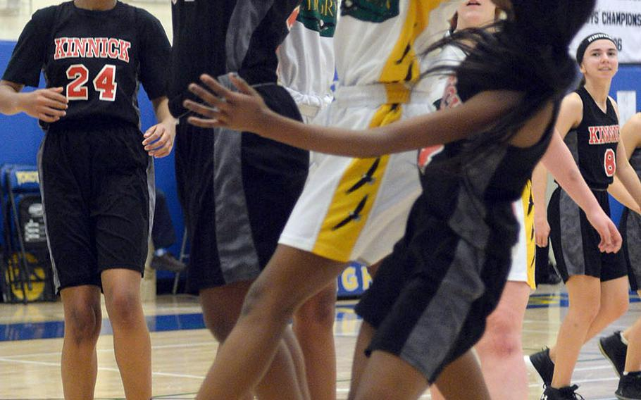 Nile C. Kinnick's Kiana Johnson and Robert D. Edgren's Naomi Andrews cannot find the handle on the ball during Friday's DODEA-Japan girls semifinal, won by the Red Devils 47-18.